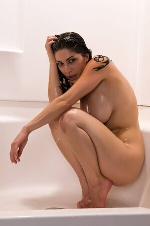 nudity: Pretty brunette crouched soaking in the shower
