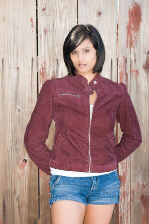 middle eastern woman: Pretty young Middle Eastern woman in a corduroy jacket Stock Photo