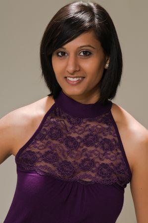 Pretty young Middle Eastern woman in a purple mini dress Фото со стока