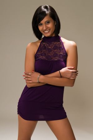 Pretty young Middle Eastern woman in a purple mini dress Imagens