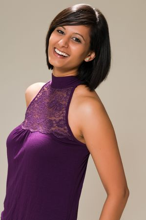 Pretty young Middle Eastern woman in a purple mini dress photo
