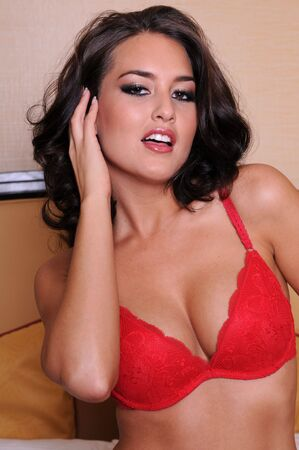Beautiful brunette in red lingerie photo