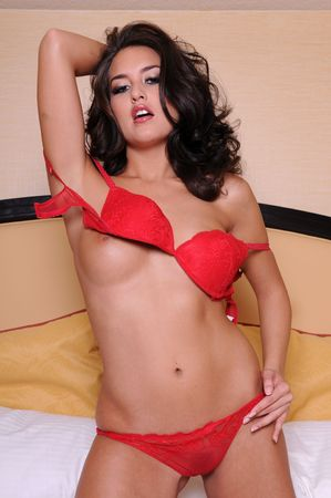 brassiere: Beautiful brunette in red lingerie Stock Photo