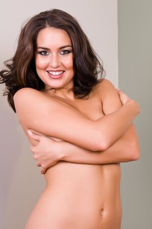 Beautiful young brunette posing topless Stock Photo - 5558257