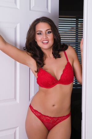 red bra: Beautiful young brunette in red bra and panties