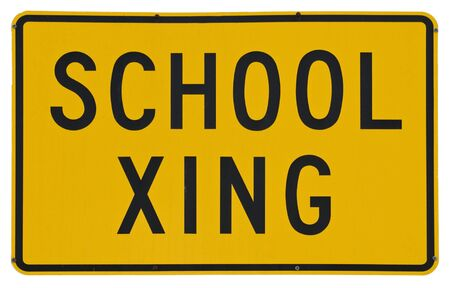 xing: School Xing yellow metal road sign isolated on white