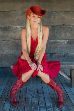 Beautiful mature blonde dressed in red Western gear photo