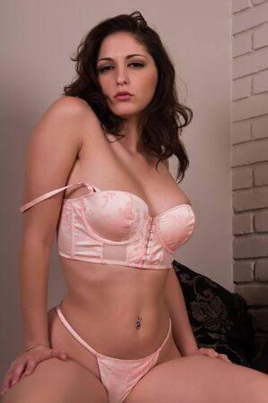 woman bra: Beautiful young brunette dressed in pink lingerie