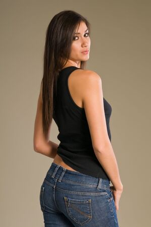 Beautiful tall brunette in black blouse and jeans Stock fotó