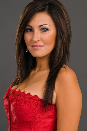 Pretty young brunette in a red corset