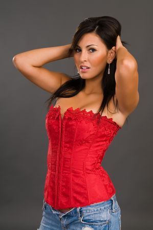 red corset: Pretty young brunette in a red corset