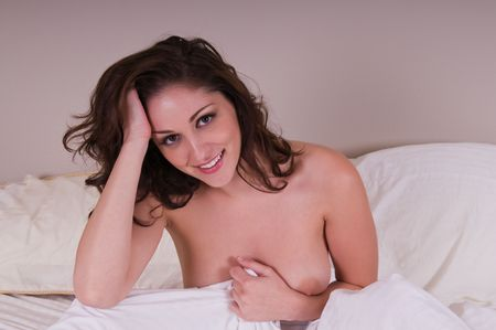 Beautiful young brunette nude in bed