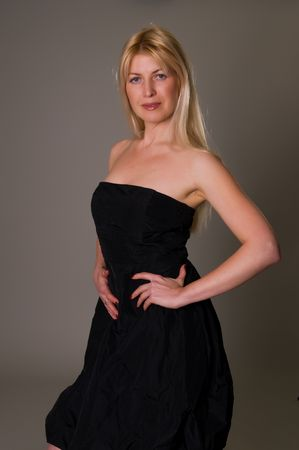 strapless: Blonde Ukrainian woman in a strapless black dress