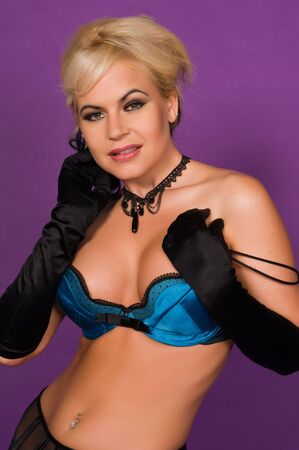 Beautiful blonde in black and blue lingerie photo