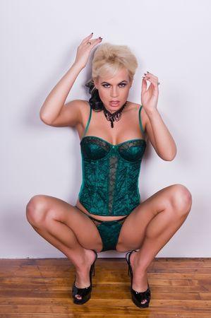 Beautiful blonde in a green corset set photo