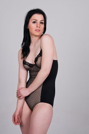 Pretty young brunette in a brown bodysuit photo