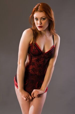 Beautiful young redhead in red and black lingerie Stock Photo - 6337622