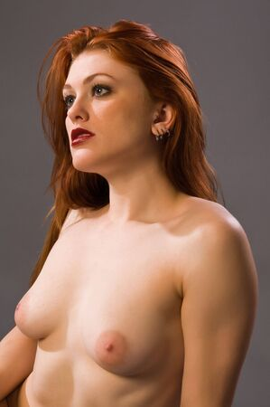 Beautiful young redhead posing nude Stock Photo - 6337670