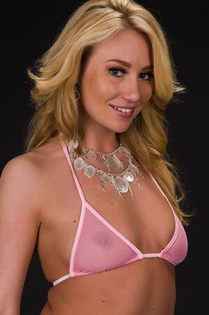 revealing: Beautiful young blonde in a revealing pink bikini