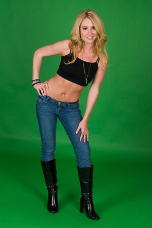 blouse sexy: Beautiful young blonde in a black top and jeans