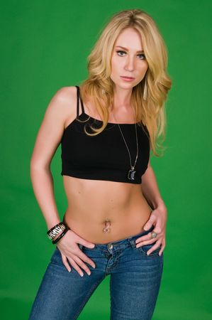 Beautiful young blonde in a black top and jeans Stock Photo - 6387066