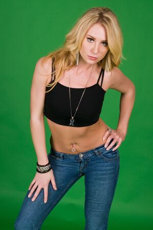 Beautiful young blonde in a black top and jeans photo
