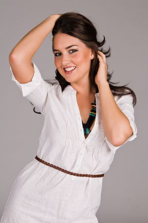 Beautiful Native American brunette in a white linen dress photo