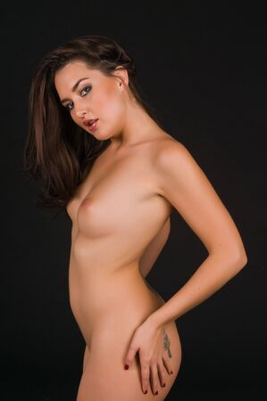Beautiful Native American brunette nude over black Stock Photo - 6547694