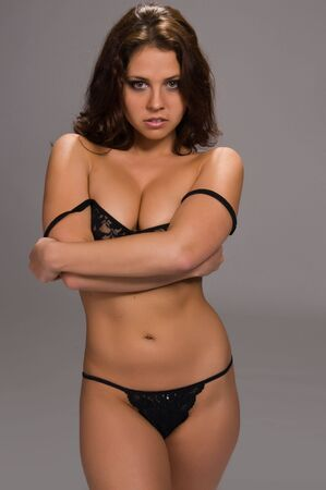 young woman panties: Beautiful young brunette dressed in black lingerie Stock Photo