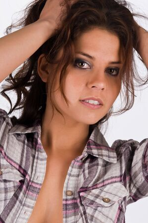 Beautiful young brunette in a plaid shirt photo
