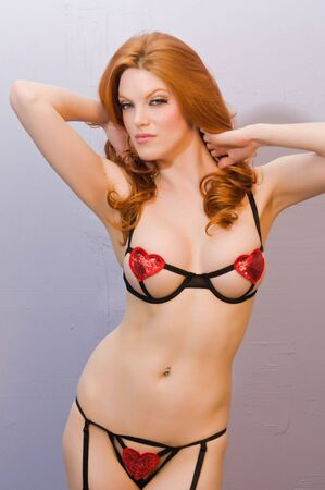 undergarments: Beautiful pale redhead in skimpy black lingerie