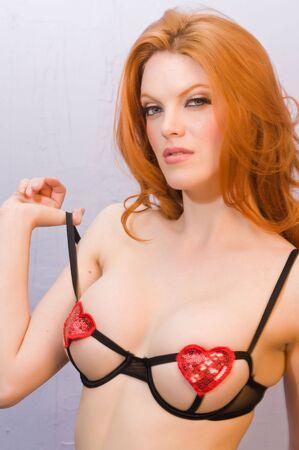 revealing: Beautiful pale redhead in skimpy black lingerie