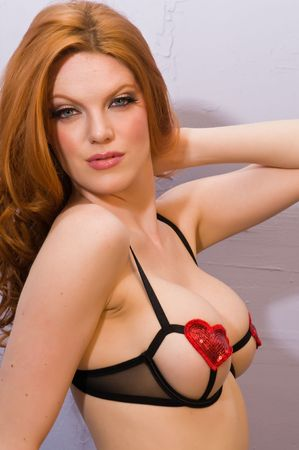 Beautiful pale redhead in skimpy black lingerie photo