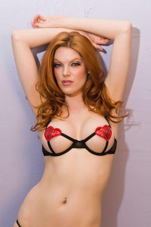 sexy bra: Beautiful pale redhead in skimpy black lingerie