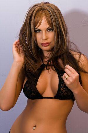 undergarment: Beautiful tall brunette dressed in black lingerie