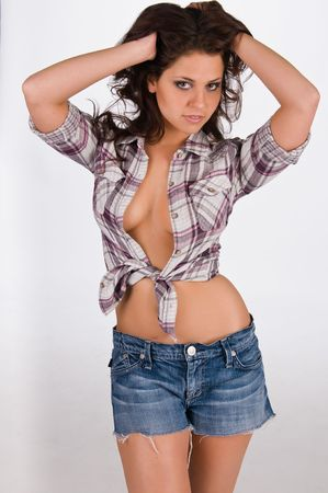 plaid shirt: Beautiful young brunette in a plaid shirt Stock Photo