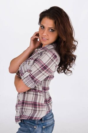 Beautiful young brunette in a plaid shirt 版權商用圖片