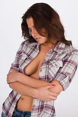 Beautiful young brunette in a plaid shirt 版權商用圖片