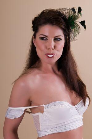 Beautiful tall brunette in a white bra photo