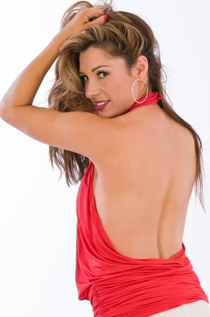 Beautiful brown haired woman in a red halter top photo