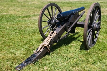Reproduction of a Civil War cannon in a field of grass
