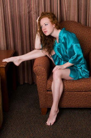 Beautiful pale redhead in a teal robe Stock Photo - 7014012