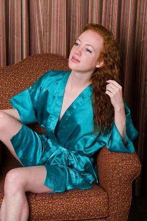 Beautiful pale redhead in a teal robe Stock Photo - 7014015