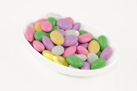 A dish of pastel colored Jordan almonds Stok Fotoğraf