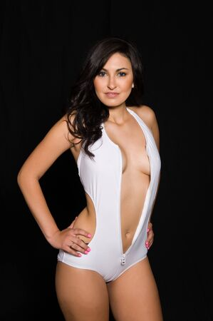 sexy latina: Pretty young brunette dressed in a white swimsuit