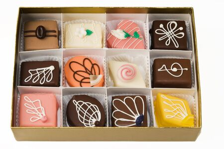 petit: An assortment of petit fours in a gold box