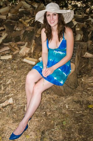 Pretty young brunette in a tie die dress