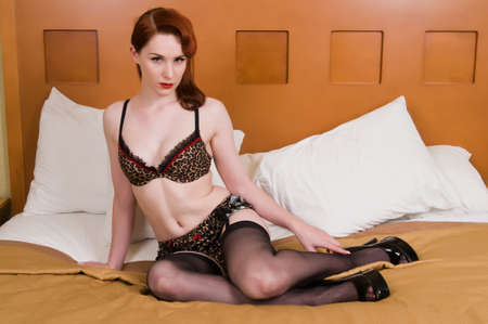 leopard print lingerie: Pretty young redhead dressed in leopard print lingerie