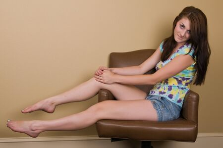 denim shorts: Pretty young brunette in a tie dyed blouse
