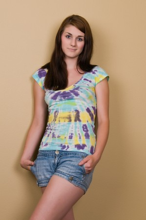 Pretty young brunette in a tie dyed blouse photo